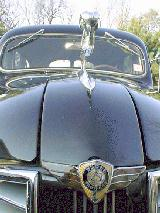 48k photo of 1937 Dodge 4-door Trunkback (Touring) Sedan, ram and badge