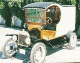 31k photo of 1914 Ford T panel delivery with Ford-A wheels