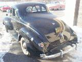 16k photo of 1940 Ford V8 DeLuxe opera coupe