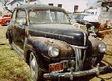 21k photo of 1941 Ford DeLuxe Tudor (2-door) Sedan