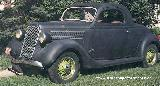 48k photo of 1935 Ford DeLuxe 3-window coupe of Aubrey Bruneau