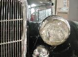 47k photo of 1935 Ford DeLuxe convertible sedan, headlight
