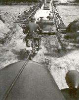 108k 1940 photo of Opel 2,0 Ltr. mascot, Maas river