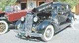 30k photo of 1937 Packard 120C 4-door touring sedan