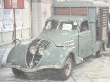 107k photo of early Peugeot 402 horse delivery box van?
