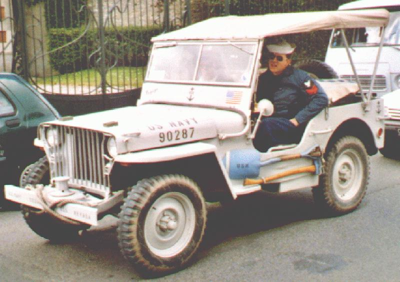 An early WW2 jeep painted light grey.